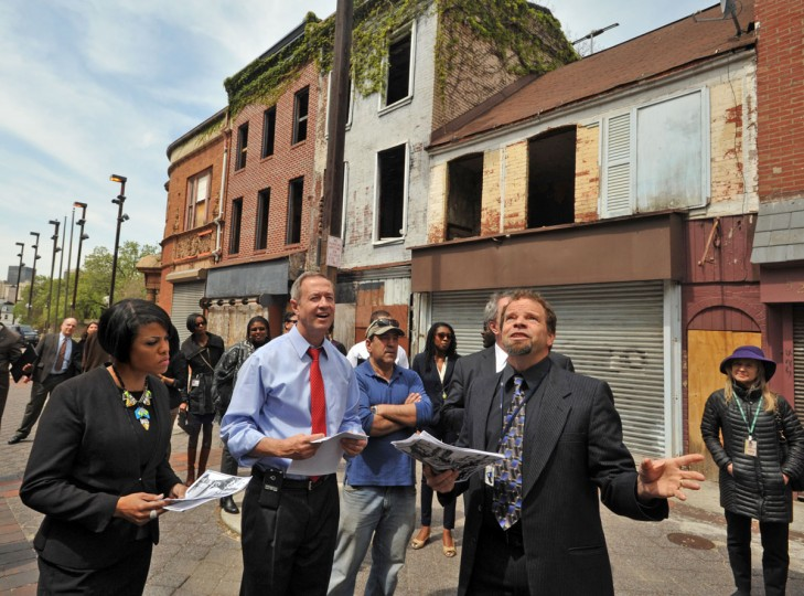 "Mayor Stephanie Rawlings Blake, left, and Governor Martin O'Malley, center, listen to Baltimore cIty planner Eric Holcomb, right, talk about Old Town Mall. A press conference was held in the 400 block of Old Town Mall to announce state funds that would be awarded for this dormant shopping district and other projects around the state. The state Department of Housing and Community Development's ""Strategic Demolition and Smart Growth Impact Fund"" will invest $5 million in 13 revitalization projects, including $2.15 million for five projects in Baltimore City. Amy Davis Baltimore Sun Staff Photographer"