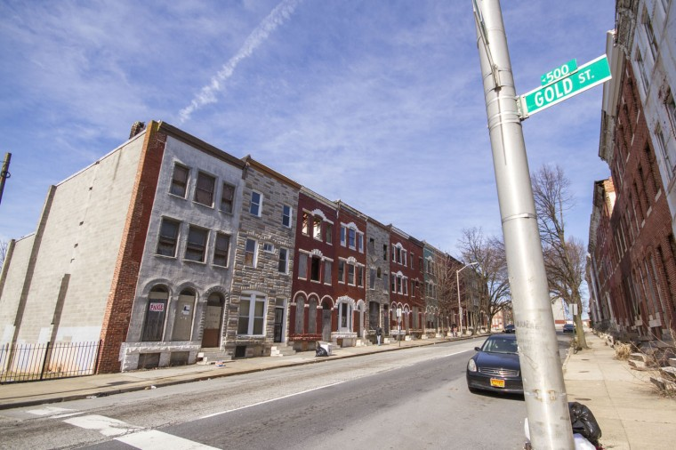 3/2015: A walk through Druid Heights shows the rowhouse architecture, many vacant or rehabbed. (Kalani Gordon/Baltimore Sun)