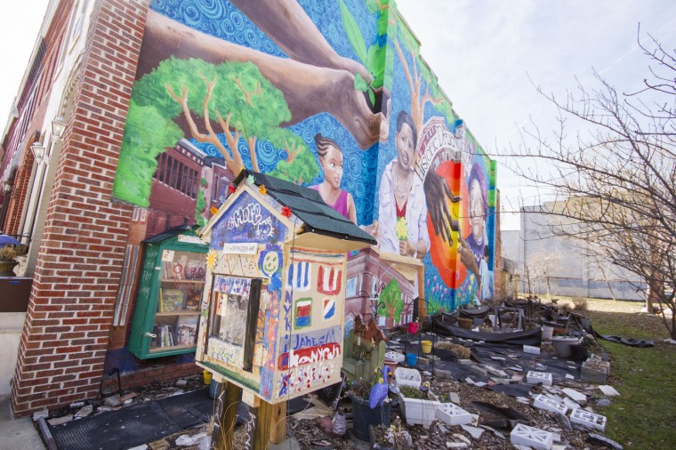 3/2015: One of the neighborhood murals, painted by Michelle Santos on the corner of Druid Hill Avenue and Presstman Street, representative of women who are important to the neighborhood. (Kalani Gordon/Baltimore Sun)