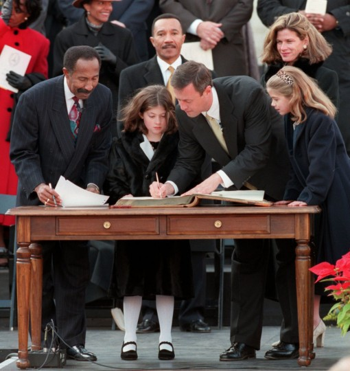 Frank M. Conaway, Clerk of the Circuit Court of Baltimore, left, witnesses newly sworn in mayor Martin O'Malley's signature in the city record as Kweisi Mfume, center back, and O'Malley's wife Katie and daughters Grace, 8, left, and Tara,7, look on. Jed Kirschbaum, Baltimore Sun