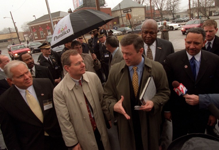 Baltimore Mayor Martin O'Malley, second from right, takes fellow Mayors from the US Conference of Mayors on a tour of a Pimlico area neighborhood. Left to right in front: Donald Plusquellic, Mayor of Akron OH; H. Brent Coles, Mayor of Boise ID; Mayor Martin O'Malley; Marc Morial, Mayor of New Orleans. Barbara Haddock Taylor, Staff