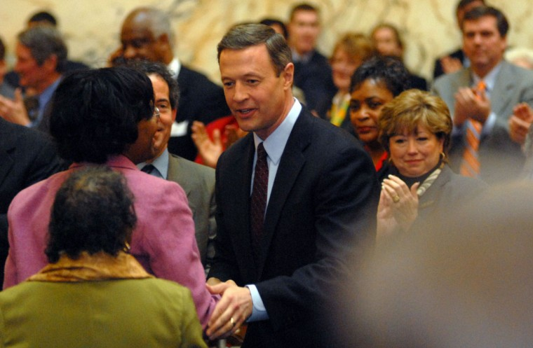 Governor Martin O'Malley greets Senator Lisa Gladden of Baltimore in 2007, left, as he enters the House chamber to give his first State of the State speech. Barbara Haddock Taylor, Staff