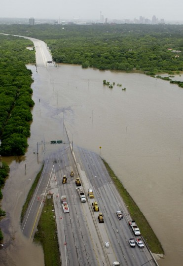 Flood waters flow over U.S. 281 just north of downtown San Antonio, Wednesday, July 3, 2002. Gov. Rick Perry issued a state disaster declaration Wednesday for 29 South and Central Texas counties after flooding rains killed at least three people and submerged hundreds of homes. (AP Photo/Eric Gay)