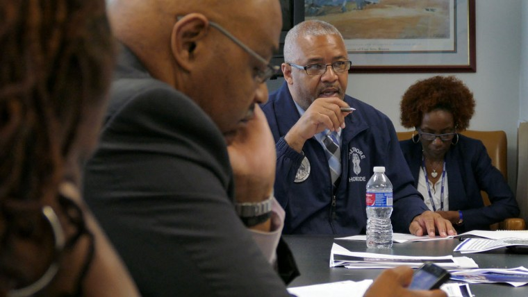 Baltimore Police Major Stanley Brandford leads a meeting inside the Professional Standards & Accountability Bureau of the Deputy Commissioner's Office, where investigators review and continue their internal investigation at department headquarters. Much of the internal investigation were recently handed over to the city state's attorney's office, who today announced charges against six officers who confronted and then placed Freddie Gray into custody on April 12, eventually resulting in what was ruled a homicide of the 25-year-old West Baltimore resident seven days later. Karl Merton Ferron/Baltimore Sun