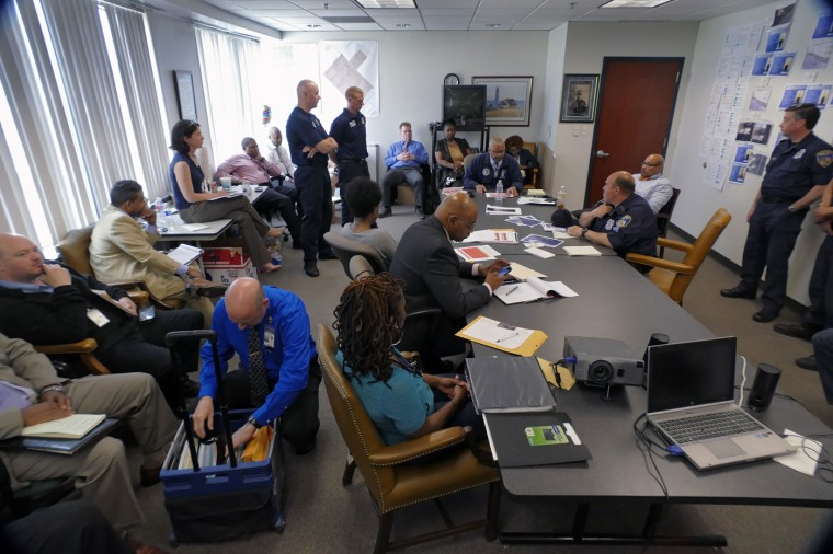 Baltimore Police Major Stanley Brandford (sitting at head of table) leads a meeting inside the Professional Standards & Accountability Bureau of the Deputy Commissioner's Office, where investigators review and continue their internal investigation at department headquarters. Much of the internal investigation were recently handed over to the city state's attorney's office, who today announced charges against six officers who confronted and then placed Freddie Gray into custody on April 12, eventually resulting in what was ruled a homicide of the 25-year-old West Baltimore resident seven days later. Karl Merton Ferron/Baltimore Sun \