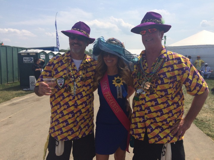 "From left, Todd Sauve, an ""immature"" 52, of Minnesota; Meghan Beer, 44, of Catonsville; and Dave Taylor, 53, also of Minnesota. Taylor said he and his family have attended the Kentucky Derby for the last 20 years, so they wanted to expand their horizons and check Preakness off the bucket list. (Quinn Kelley/Baltimore Sun)"