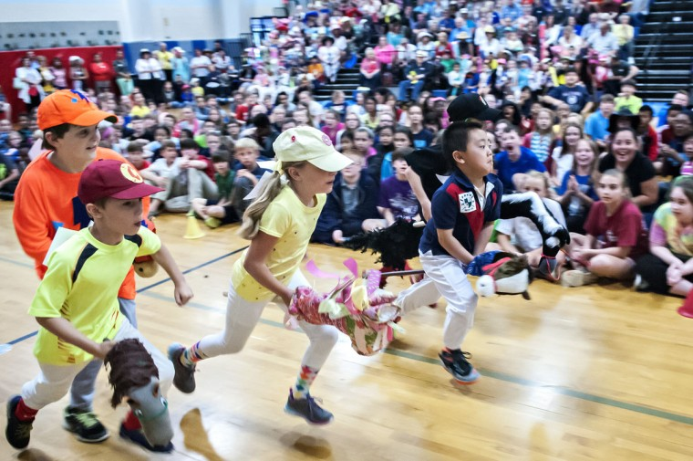 Briarwood Elementary School students compete in the stick horse derby at the school Friday, May 1, 2015, in Bowling Green, Ky. (Bac Totrong/Daily News via AP)