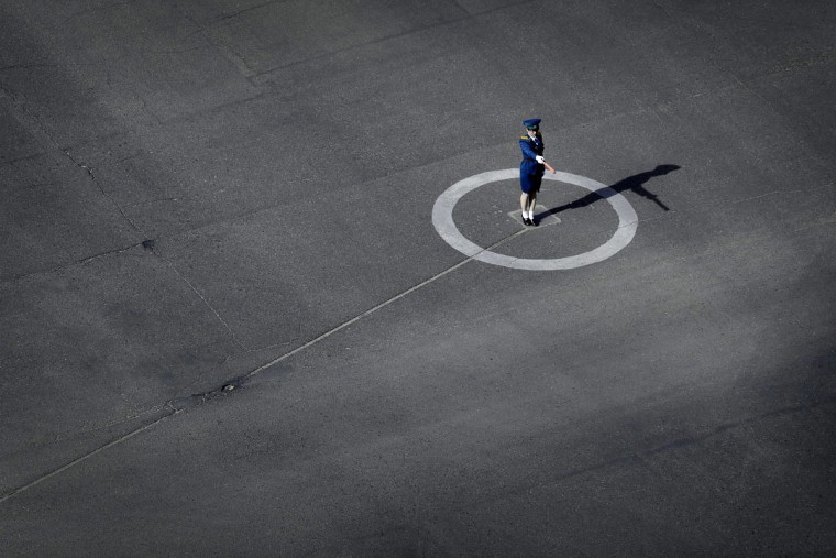 A North Korean traffic police woman performs her duties, Monday, May 4, 2015 in Pyongyang, North Korea. (AP Photo/Wong Maye-E)