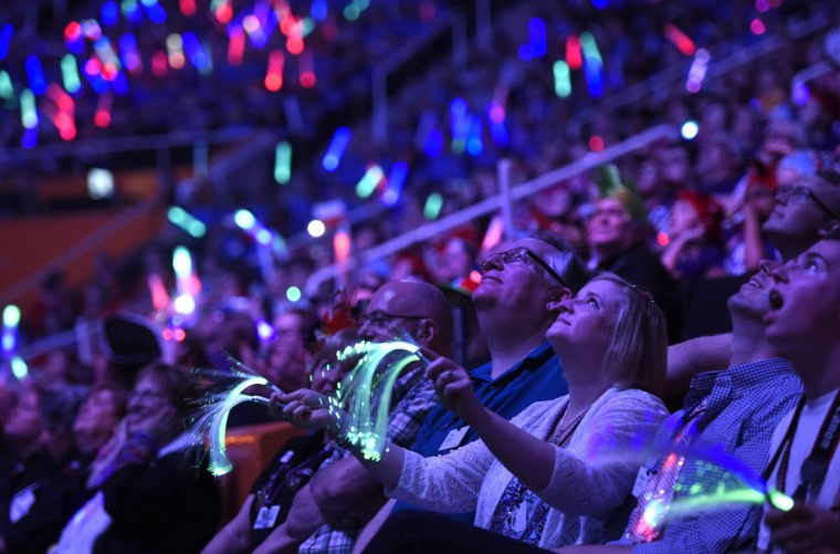 "Spectators watch the Destination Imagination Global Finals opening ceremonies in Knoxville, Tenn. on Wednesday, May 20, 2015. Apollo 11 astronaut Buzz Aldrin welcomed participants to the event, which bills itself as ""the world's largest celebration of creativity and innovation."" (Adam Lau/Knoxville News Sentinel via AP)"