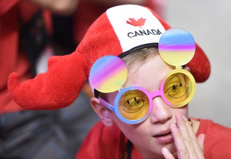 "A competitor from Canada watches the Destination Imagination Global Finals opening ceremonies in Knoxville, Tenn., Wednesday, May 20, 2015. Apollo 11 astronaut Buzz Aldrin welcomed participants to the event, which bills itself as ""the world's largest celebration of creativity and innovation."" (Adam Lau/Knoxville News Sentinel via AP)"