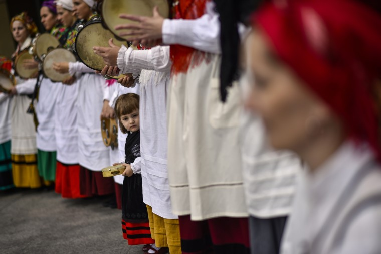 A young regional dancer takes part in a dance, in Plaza del Castillo square, in Pamplona, northern Spain. With a rich traditions on dress and regional music, a lot of regional groups perform on the street during spring season. (Alvaro Barrientos/Associated Press)