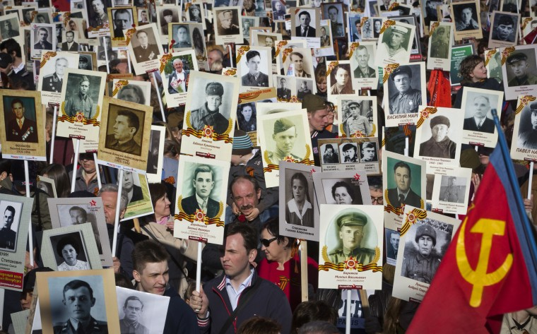 people march carrying portraits of their ancestors, veterans and participants in World War II, as they celebrate the 70th anniversary of the defeat of the Nazis in World War II. About 100,000 people walked in a march named 'Immortal Regiment' while carrying portraits of their relatives who fought in World War II. (Dmitry Lovetsky) ORG XMIT: XDL105