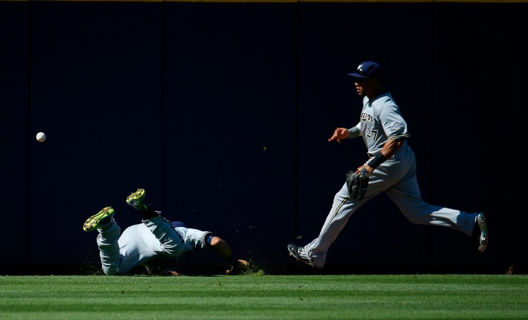 Carlos Gomez runs to the ball after Gerardo Parra of the Milwaukee Brewers failed to catch a double hit by A.J. Pierzynski of the Atlanta Braves in the second inning at Turner Field in Atlanta, Georgia. (Kevin C. Cox/Getty Images)