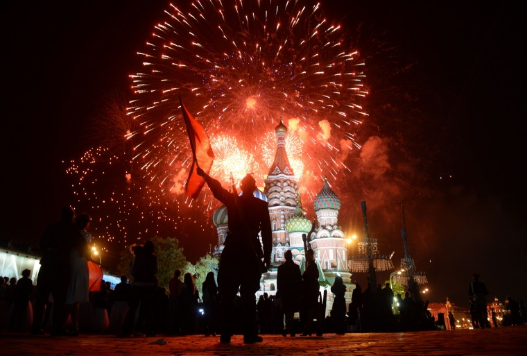 Fireworks explode above Moscow's Red Square during the Victory Day celebrations marking the 70th anniversary of the 1945 victory over Nazi Germany. (Host Photo Agency/RIA via AFP/Getty Images)