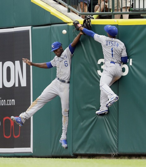 Kansas City Royals center fielder Lorenzo Cain (6) and right fielder Jarrod Dyson (1) misplay a triple hit by Detroit Tigers' Nick Castellanos during the sixth inning of their game in Detroit. (Carlos Osorio/Associated Press)