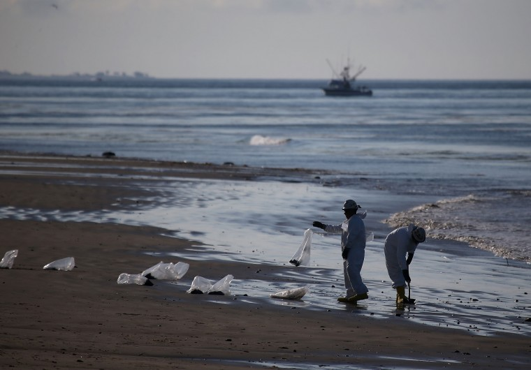 Workers continue to clean oil from Refugio State Beach in Goleta, California. California Gov. Jerry Brown declared a State of Emergency after over 100,000 gallons of oil spilled from an abandoned pipeline on the land near Refugio State Beach, spreading over about nine miles of beach within hours. The largest oil spill ever in U.S. waters at the time occurred in the same section of the coast in 1969 where numerous offshore oil platforms can be seen, giving birth to the modern American environmental movement. (Justin Sullivan/Getty Images)