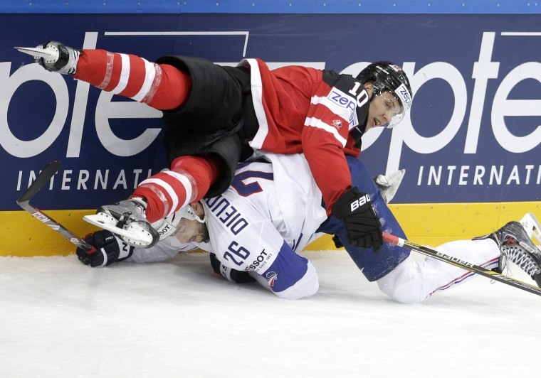 Canada's Brayden Schenn falls on top of France's Benjamin Dieude-Fauvel as they collide during the Hockey World Championships Group A match in Prague, Czech Republic. (Petr David Josek/Associated Press)