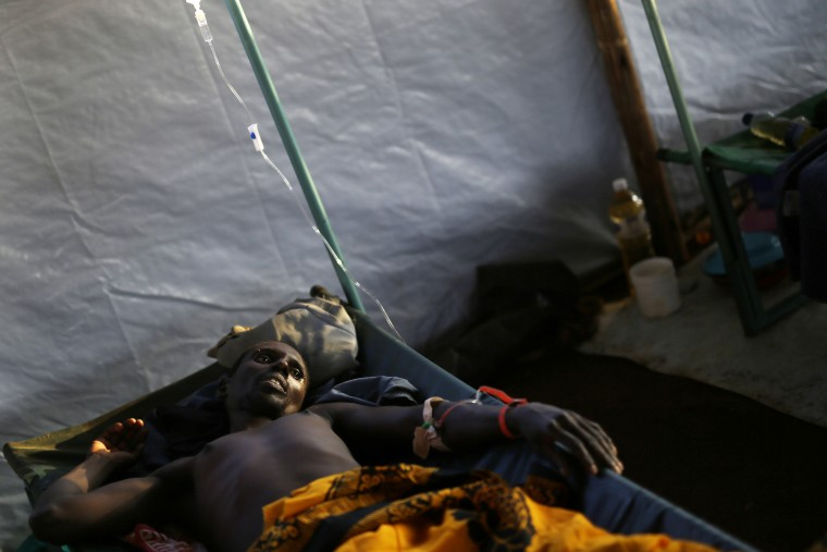 A refugee from Burundi suffering from Cholera lays in a makeshift clinic at the stadium in Kigoma, Tanzania. An outbreak of cholera has infected 3,000 people in a Tanzanian border region where refugees fleeing political unrest in Burundi have massed, the U.N. Refugee Agency said. Some 300 to 400 new cases of cholera are being reported daily. At least 31 people — 29 refugees and two Tanzanians — already have died of the disease, according to UNHCR. More than 64,000 Burundians have fled to Tanzania in recent weeks, UNHCR said, escaping the unrest sparked by their president's bid for a third term that many say is unconstitutional. (Jerome Delay/Associated Press)