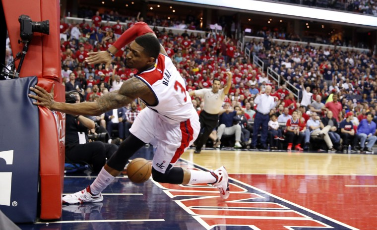 Washington Wizards guard Bradley Beal (3) collides with the goal stanchion after he was shoved by Atlanta Hawks guard Jeff Teague, and it was ruled a flagrant foul, in the first half of Game 3 of the second round of the NBA basketball playoffs, in Washington. (Alex Brandon/Associated Press)