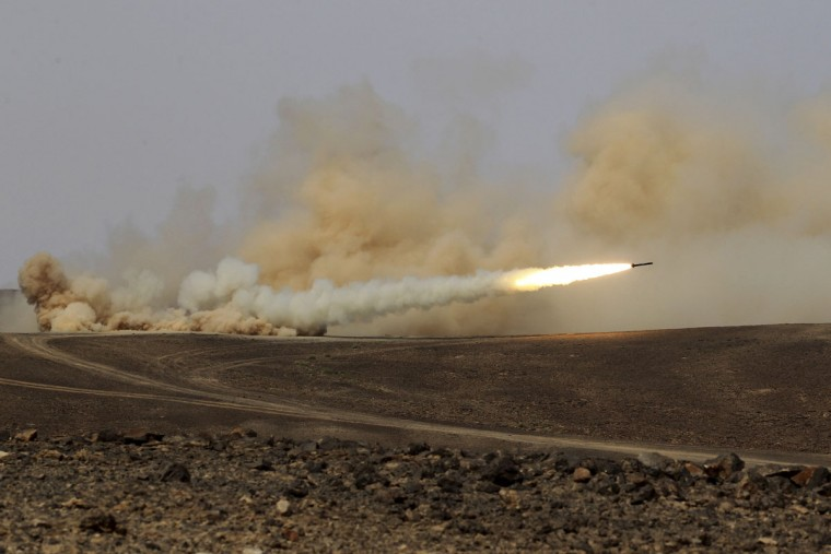 A rocket is fired during 18-nation military exercises in a field near the border with Saudi Arabia, in Mudawara, 280 kilometers (174 miles) south of Amman, Jordan, Monday, May 18, 2015. (AP Photo/Raad Adayleh)