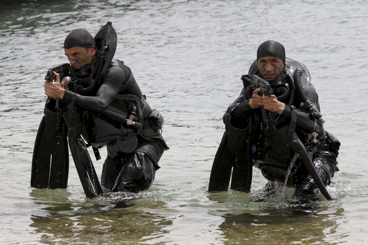 Jordanian forces practice a drill to free a ship seized by mock terrorists during 18-nation military exercises at Aqaba's seaport, 330 kilometers (205 miles) south of Amman, Jordan, Monday, May 18, 2015. (AP Photo/Raad Adayleh)