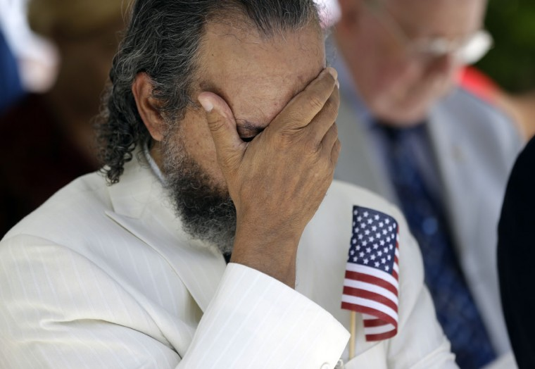 Reverend Edward Hernandez bows his head during a Memorial Day event in honor of veterans who died in service to the country, Monday, May 25, 2015, in North Miami Beach, Fla. Hernandez served in the Vietnam War with the U.S. Air Force. (AP Photo/Lynne Sladky)
