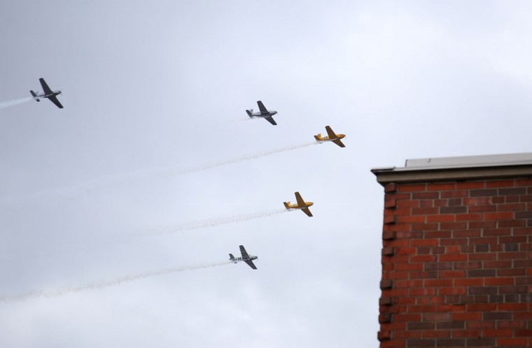 Military aircraft from the World War II era fly over downtown Muskegon, Mich., Monday, May 25, 2015, to kick off the Memorial Day parade. (Andraya Croft/The Muskegon Chronicle via AP)