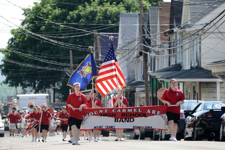 The Mount Carmel Area High School Band, from Mount Carmel, Pa., performs during a Memorial Day parade Monday, May 25, 2015, in Atlas, Pa. A service at the Atlas Fire Company Community Park was held after the parade. (Larry Deklinski/The News-Item via AP)