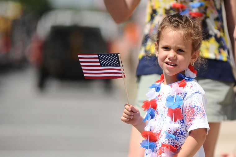 Molly Miller, of Kulpmont, watches a Memorial Day parade Monday, May 25, 2015, in Kulpmont, Pa. A service followed the parade. (Larry Deklinski/The News-Item via AP)