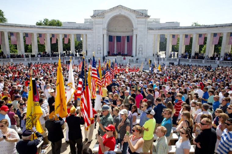 Color and honor guards arrive at the beginning of a Memorial Day ceremony at Arlington National Cemetery in Arlington, Va., Monday May 25, 2015. (AP Photo/Jacquelyn Martin)