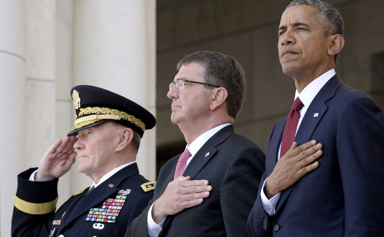 Joint Chiefs of Staff Chairman Martin Dempsey, from left, Defense Secretary Ash Carter and U.S. President Barack Obama attend a Memorial Day event at Arlington National Cemetery on Monday, May 25, 2015, in Arlington, Va. (Olivier Douliery/Abaca Press/TNS)