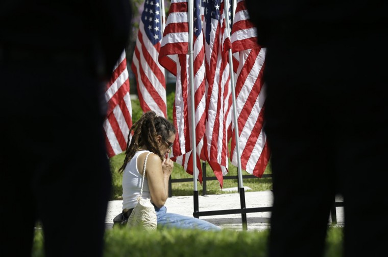 Shoshanna Crumpler, of North Miami Beach, prays during a Memorial Day event, Monday, May 25, 2015, in North Miami Beach, Fla. (AP Photo/Lynne Sladky)