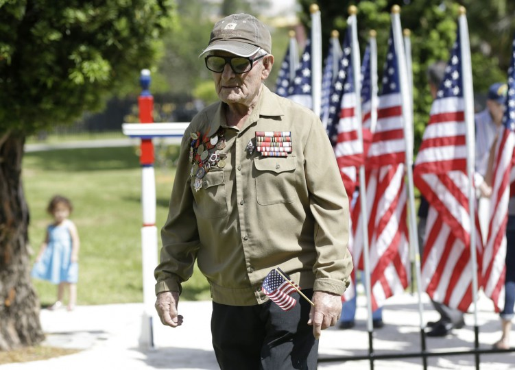 Veteran Zalman Greenberg, 90, of North Miami Beach, walks away following a Memorial Day event in honor of veterans who died in service to the country, Monday, May 25, 2015, in North Miami Beach, Fla. Greenberg, who is Russian, fought with Russia against the Nazis in WWII. (AP Photo/Lynne Sladky)