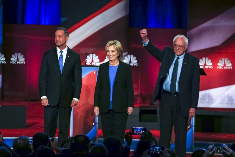 Democratic presidential candidate, former Maryland Gov. Martin O'Malley , left, Democratic presidential candidate, Hillary Clinton and Democratic presidential candidate, Sen. Bernie Sanders, I-Vt, stand together before the start of the NBC, YouTube Democratic presidential debate at the Gaillard Center, Sunday, Jan. 17, 2016, in Charleston, S.C. (AP Photo/Stephen B. Morton)