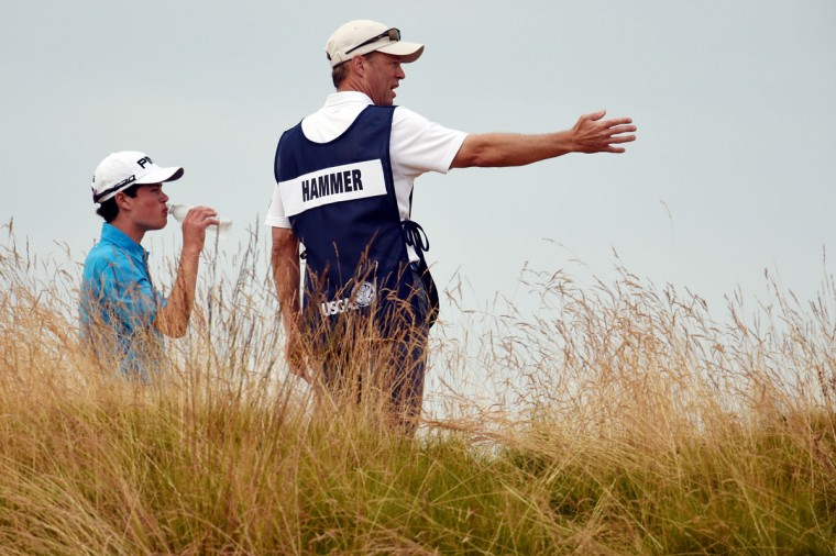 Amateur Cole Hammer lines up a shot with his caddie/father Gregg Hammer during the first round of the 115th U.S. Open Championship at Chambers Bay on June 18, 2015 in University Place, Washington. (Photo by Ross Kinnaird/Getty Images)
