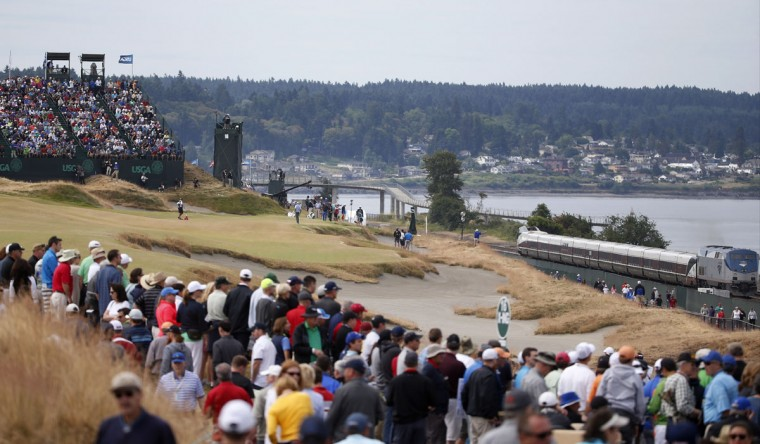 Matt Kuchar putts on the 17th hole during the first round of the U.S. Open golf tournament at Chambers Bay on Thursday, June 18, 2015 in University Place, Wash. (AP Photo/Lenny Ignelzi)