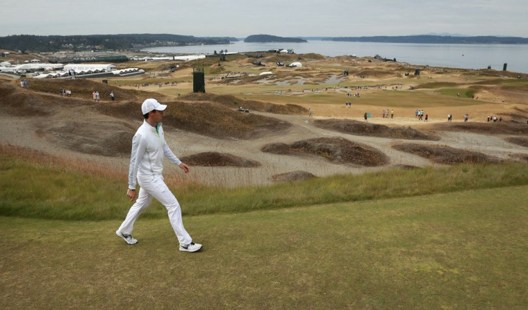 Rory McIlroy walks to the 14th green during the first round of the U.S. Open golf tournament at Chambers Bay on Thursday, June 18, 2015 in University Place, Wash. (AP Photo/Charlie Riedel)