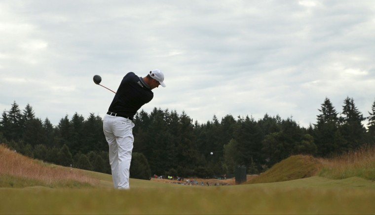 Martin Kaymer, of Germany, watches his tee shot on the 13th hole during the first round of the U.S. Open golf tournament at Chambers Bay on Thursday, June 18, 2015 in University Place, Wash. (AP Photo/Charlie Riedel)