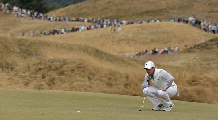 Rory McIlroy lines up his putt on the 13th hole during the first round of the U.S. Open golf tournament at Chambers Bay on Thursday, June 18, 2015 in University Place, Wash. (AP Photo/Charlie Riedel)