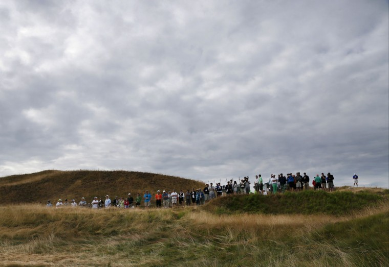 Fans line the second fairway during the first round of the U.S. Open golf tournament at Chambers Bay on Thursday, June 18, 2015 in University Place, Wash. (AP Photo/Matt York)