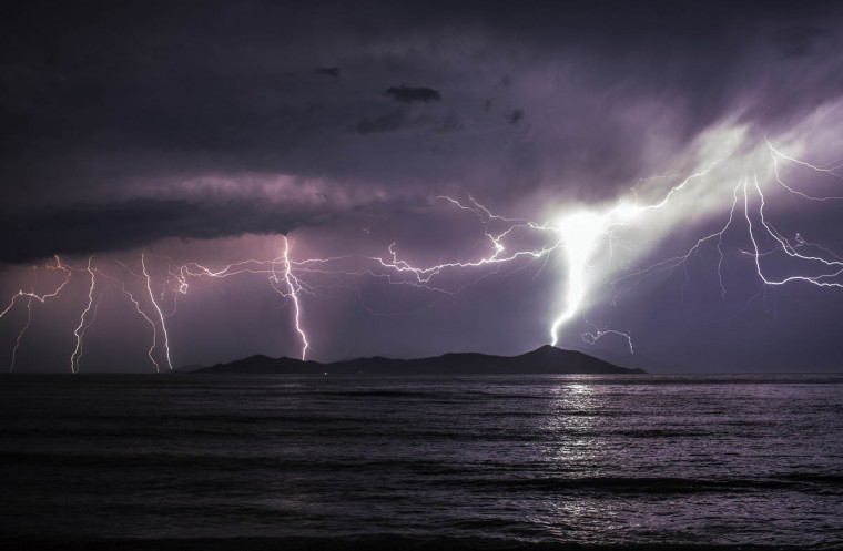 Lightning strikes over the Greek Island of Pserimos in Kos, Greece. Migrants are continuing to arrive on the Greek Island of Kos from Turkey who's shoreline lies approximately 5 Km away. Around 30,000 migrants have entered Greece so far in 2015, with the country calling for more help from its European Union counterparts. (Dan Kitwood/Getty Images)