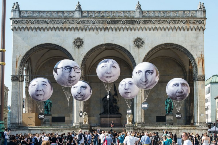 Activists have installed balloons decorated with the portraits of (L-R) Japanese Prime Minister Shinzo Abe, French President Francois Hollande, Italian Prime Minister Matteo Renzi, German Chancellor Angela Merkel, Canadian Prime Minister Stephen Harper, British Prime Minister David Cameron and US President Barack Obama during a protest activity against the G7 summit on June 5, 2015 in Munich, Germany. Germany will host the G7 summit at Elmau Castle near Garmisch Partenkirchen, southern Germany, on June 7 and June 8, 2015. (Photo by Joerg Koch/Getty Images)