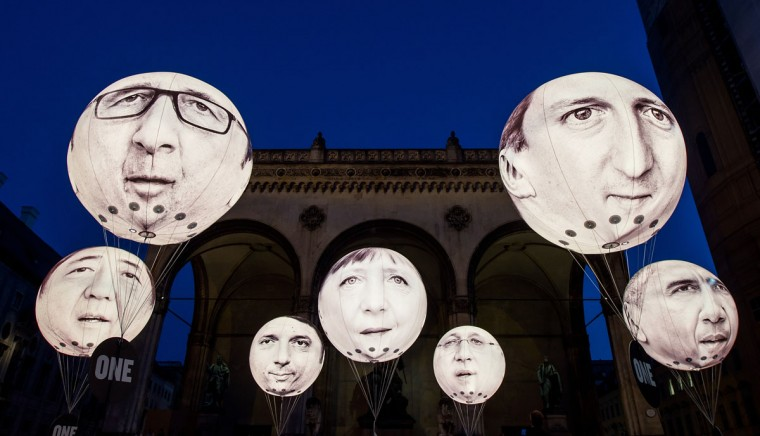 Activists have installed balloons decorated with the portraits of (L-R) Japanese Prime Minister Shinzo Abe, French President Francois Hollande, Italian Prime Minister Matteo Renzi, German Chancellor Angela Merkel, Canadian Prime Minister Stephen Harper, British Prime Minister David Cameron and US President Barack Obama during a protest activity against the G7 summit on June 5, 2015 in Munich, Germany. Germany will host the G7 summit at Elmau Castle near Garmisch Partenkirchen, southern Germany on June 7 and 8, 2015. (Photo by Joerg Koch/Getty Images)