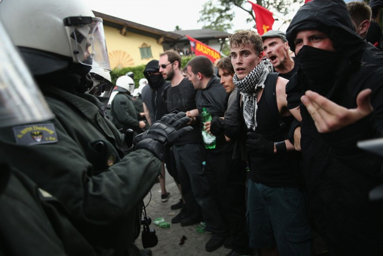Anti-G7 protesters confront riot police during scuffles that involved tear gas and pepper spray during a march through the city center the day before the summit of G7 leaders on June 6, 2015 in Garmisch-Partenkirchen, Germany. G7 leaders will meet at nearby Schloss Elmau on June 7-8 and protesters are holding a variety of gatherings and demonstrations to voice their opposition. (Photo by Sean Gallup/Getty Images)