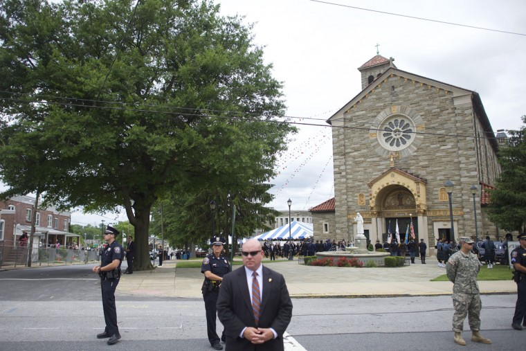 Security personnel monitor activity across the street as the hearse and Biden family arrive for a mass of Christian burial at St. Anthony of Padua Church for former Delaware Attorney General Beau Biden, on June 6, 2015 in Wilmington, Delaware. U.S. President Barack Obama is expected to deliver a eulogy for the son of Vice President Joe Biden after he died at 46 following a two-year battle with brain cancer. (Photo by Mark Makela/Getty Images)