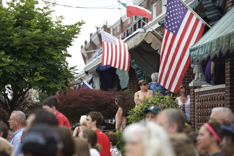 Onlookers gather across the street before the hearse and Biden family arrive for a mass of Christian burial at St. Anthony of Padua Church for former Delaware Attorney General Beau Biden, on June 6, 2015 in Wilmington, Delaware. U.S. President Barack Obama is expected to deliver a eulogy for the son of Vice President Joe Biden after he died at 46 following a two-year battle with brain cancer. (Photo by Mark Makela/Getty Images)