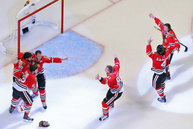 The Chicago Blackhawks celebrate after defeating the Tampa Bay Lightning by a score of 2-0 in Game Six to win the 2015 NHL Stanley Cup Final at the United Center on June 15, 2015 in Chicago, Illinois. (Photo by Bruce Bennett/Getty Images)