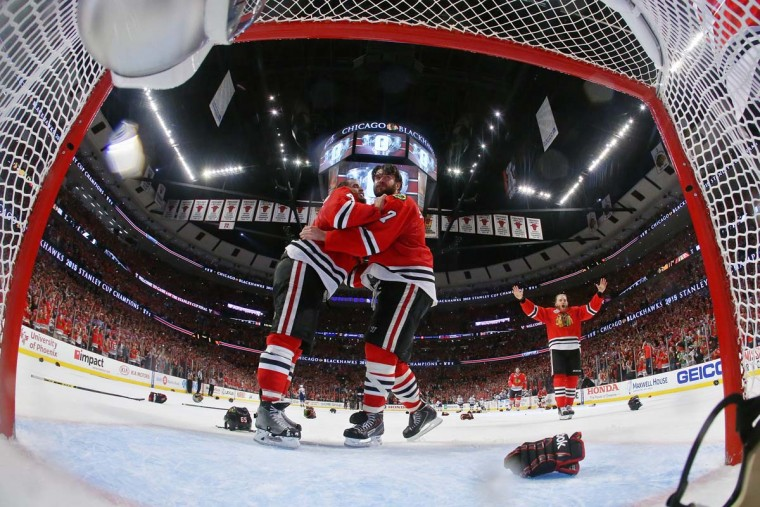 Niklas Hjalmarsson #4, Brent Seabrook #7 and Patrick Kane #88 of the Chicago Blackhawks celebrate after defeating the Tampa Bay Lightning by a score of 2-0 in Game Six to win the 2015 NHL Stanley Cup Final at the United Center on June 15, 2015 in Chicago, Illinois. (Photo by Bruce Bennett/Getty Images)
