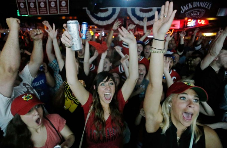 Kimberly Garner (L), Kara Christopher (C) and Jena Didier (R), all of Chicago, celebrate a goal during Game Six of the NHL 2015 Stanley Cup Final at Sluggers World Class Sports Baron June 15, 2015 in Chicago, Illinois. (Photo by Jon Durr/Getty Images)