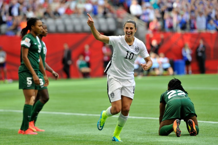 Carli Lloyd #10 celebrates after teammate Abby Wambach #20 of the United States scores a goal in the first half against Nigeria in the Group D match of the FIFA Women's World Cup Canada 2015 at BC Place Stadium on June 16, 2015 in Vancouver, Canada. (Rich Lam/Getty Images)